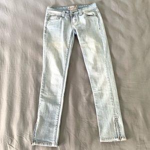 Light wash vintage blue jeans with zipper details